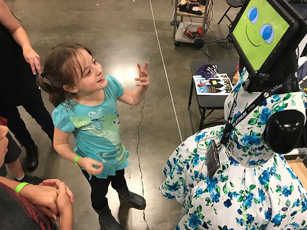 child talks with robot
